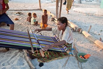 Woman weaving cloth, P. Buaya, Alor