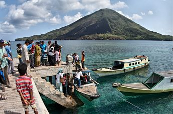 Bus service in the Banda Islands.  Background: Gunung Api volcano.