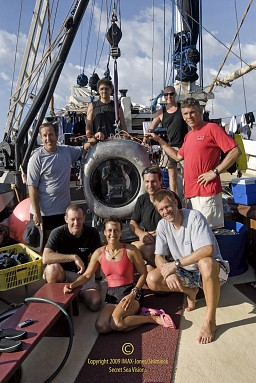 Howard Hall (right standing), Michele Hall (in front of IMAX camera) and film crew aboard The Seven Seas in Komodo National Park