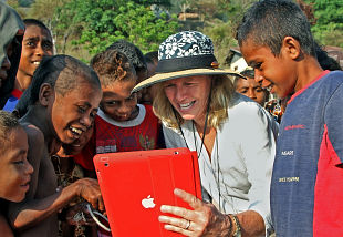 Author Nancy Baron shows village children a picture she took of them, by Kenneth R. Weiss