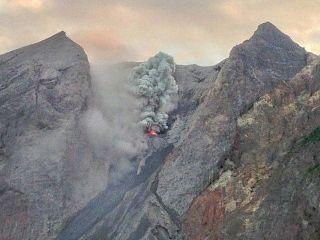 Komba erupting
